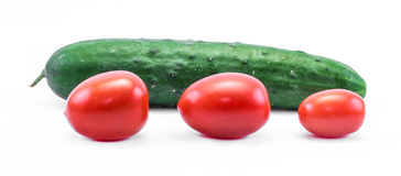 Green cucumber and red tomatoes on a white background - side view Royalty Free Stock Photos