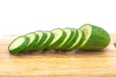 Green cucumber with slices Royalty Free Stock Photos