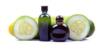 Green cucumber spa oil Stock Photography