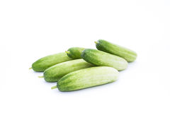 The green cucumbers. Isolated on white Stock Photos