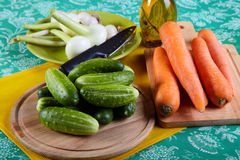 Green cucumbers with onions garlic and carrots Royalty Free Stock Photography