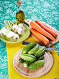 Green cucumbers with onions garlic and carrots Stock Images