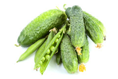 Green cucumbers and peas isolated Stock Photos