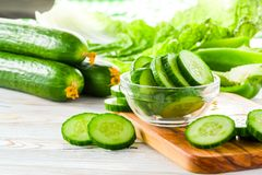 Green cucumbers on the table royalty free stock photos