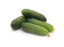 Green cucumbers on white Stock Photography