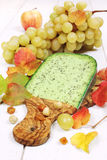 Green cumin pesto cheese, grape and autumn leaves Royalty Free Stock Photo