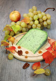 Green cumin pesto cheese, grape and autumn leaves Royalty Free Stock Image