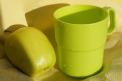 Green cup and apple Stock Photography