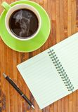 Green cup and book Royalty Free Stock Photos