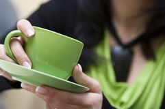 Green cup of coffee royalty free stock image