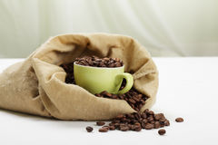 Green cup with coffee in bag Stock Image