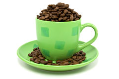 Green cup with coffee beans Royalty Free Stock Images