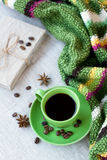 Green cup of coffee with coffee beans and anise Royalty Free Stock Photo