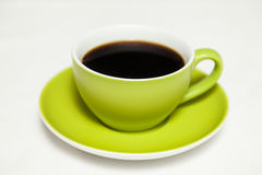 Green cup of coffee Stock Images