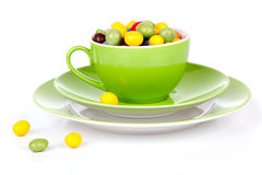 Green cup with colorful candies Royalty Free Stock Photo