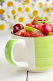 Green cup with fruits Royalty Free Stock Photos