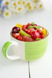 Green cup with fruits Royalty Free Stock Image