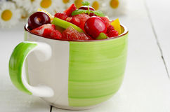 Green cup with fruits Royalty Free Stock Photography