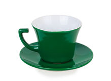 Green cup on green saucer Royalty Free Stock Image