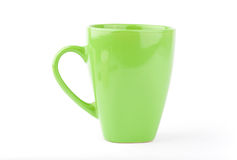 Green cup isolated on a white. Backgrounds royalty free stock images