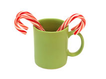 Green cup with lollipops sticks isolated Royalty Free Stock Images