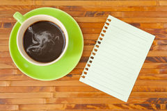 Green cup and note paper Royalty Free Stock Photo