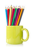 Green cup with pencils Stock Photo
