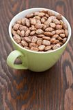 Green cup with pinto beans Stock Photography