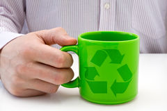 Green cup with recycled symbol Stock Images