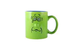 Green cup with sad face Stock Image