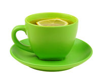 Green cup of tea with lemon Stock Photography