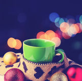 Green cup, warm scraf with heart pattern and festive glitter chr. Istmas decoration ball (Filtered image processed retro effect Royalty Free Stock Photos