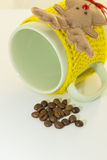 Green cup with yellow bandage, mug rests Stock Photography