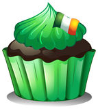 A green cupcake with the flag of Ireland Royalty Free Stock Photography