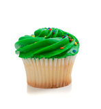 Green Cupcake with sprinkles on white Royalty Free Stock Images