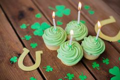 Green cupcakes, horseshoes and shamrock Royalty Free Stock Photo