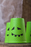 Green cups with ghost faces Royalty Free Stock Photo