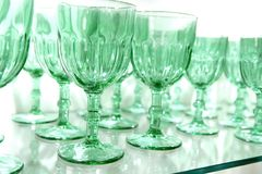 Green cups rows glass crystal kitchenware Stock Photo