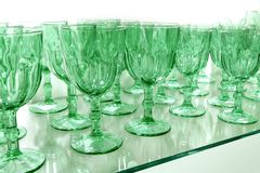 Green cups rows glass crystal kitchenware Royalty Free Stock Photos