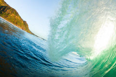 Green Curl. A green back lit wave curling over Royalty Free Stock Images