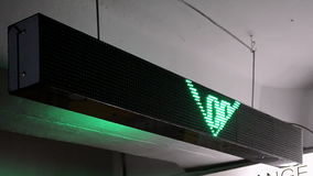 Green currency exchange rate on led display on Ukrainian language, numbers diversity, stock footage