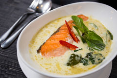 Green curry with grilled salmon. Kang kiaw wan (Green curry with grilled salmon) in white bowl Royalty Free Stock Photo