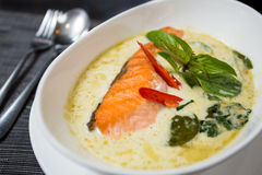 Green curry with grilled salmon. Kang kiaw wan (Green curry with grilled salmon) in white bowl Stock Images