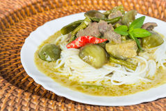 Green curry with meat on top of noodle Royalty Free Stock Photos