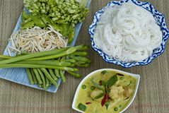 Green Curry and Rice Noodles. A Thai set-meal of chicken green curry and rice noodles royalty free stock photos