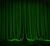 Green curtain in theater. Green curtain with spot light on theater or cinema stage vector illustration