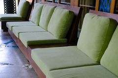 Green cushion on wooden sofa chair. living design for home. Interior stock photography