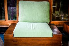 Green cushion on wooden sofa chair. living design for home. Interior royalty free stock photography