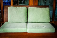 Green cushion on wooden sofa chair. living design for home. Interior stock photos