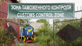 Green customs control zone signboard. Abandoned railway carirage on a background stock video footage